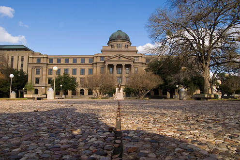 This is the Academic Building at Texas A&M University. The building was completed in 1914 and there is a replica of the Liberty Bell located inside the dome of the building.